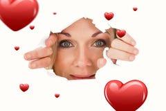 Imagem composta da mulher que olha através do papel rasgado Fotos de Stock Royalty Free