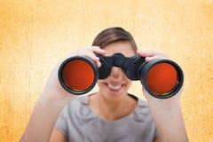 Imagem composta da mulher que olha através dos telescópios pequenos Fotografia de Stock Royalty Free