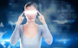 Imagem composta da mulher que usa vidros video virtuais Fotografia de Stock Royalty Free