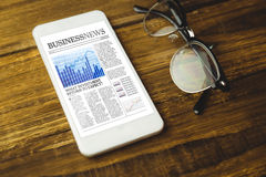 Imagem composta da opinião de ângulo alto do telefone celular e dos monóculos Imagem de Stock Royalty Free