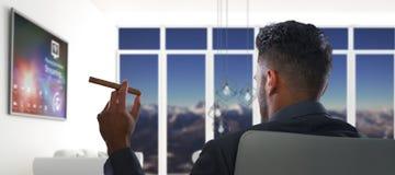 Imagem composta da opinião traseira o homem de negócios que guarda o charuto fotografia de stock royalty free
