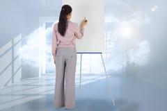 Imagem composta da pintura da mulher de negócios em uma armação Foto de Stock Royalty Free