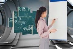 Imagem composta da pintura da mulher de negócios em uma armação Imagem de Stock
