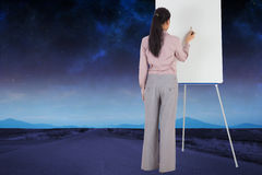 Imagem composta da pintura da mulher de negócios em uma armação Foto de Stock