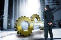 Imagem composta da posição e da vista do homem de negócios foto de stock
