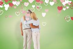 Imagem composta da posição e da vista felizes dos pares Fotografia de Stock Royalty Free