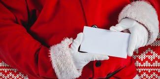 Imagem composta da seção mestra de Papai Noel que guarda o cartaz vazio fotos de stock royalty free
