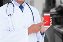 Imagem composta da seção mestra do doutor masculino que aponta no telefone celular fotografia de stock royalty free