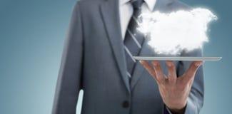 Imagem composta da seção mestra do homem de negócios com tabuleta digital 3d Fotos de Stock Royalty Free