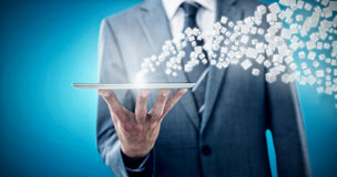 Imagem composta da seção mestra do homem de negócios com tabuleta digital 3d Foto de Stock Royalty Free