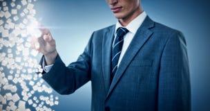 Imagem composta da seção mestra do homem de negócios elegante que aponta 3d Imagens de Stock Royalty Free