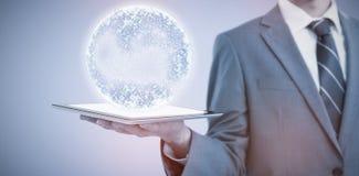 Imagem composta da seção mestra do homem de negócios que guarda o tablet pc 3d Fotos de Stock