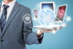 Imagem composta da seção mestra do homem de negócios que guarda o tablet pc 3d Fotos de Stock Royalty Free