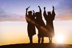 Imagem composta da silhueta do graduado Foto de Stock