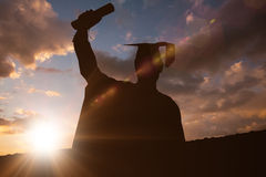 Imagem composta da silhueta do graduado Fotografia de Stock Royalty Free