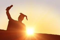 Imagem composta da silhueta do graduado Fotografia de Stock