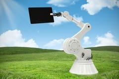 Imagem composta da tabuleta digital com o robô contra o fundo branco 3d Fotos de Stock Royalty Free