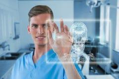 Imagem composta da tela invisível tocante 3d da enfermeira masculina feliz Fotografia de Stock