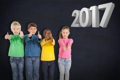 Imagem composta das crianças bonitos que mostram os polegares acima fotos de stock royalty free
