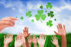 Imagem composta das mãos que aumentam no ar Foto de Stock Royalty Free