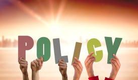 Imagem composta das mãos que sustentam a política Foto de Stock Royalty Free