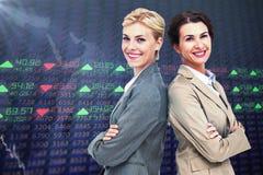 Imagem composta das mulheres de negócios sérias que estão para trás sobre traseiras Fotos de Stock Royalty Free