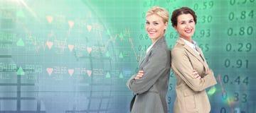 Imagem composta das mulheres de negócios sérias que estão para trás sobre traseiras Imagem de Stock Royalty Free