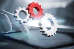 Imagem composta das rodas denteadas e das rodas brancas e vermelhas Imagem de Stock Royalty Free