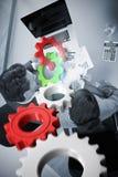 Imagem composta das rodas denteadas e das rodas brancas e vermelhas Fotos de Stock Royalty Free