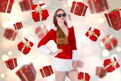 Imagem composta de óculos de sol vestindo da menina fresca de Santa Fotografia de Stock Royalty Free
