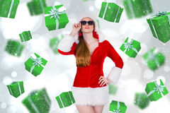 Imagem composta de óculos de sol vestindo da menina fresca de Santa Imagem de Stock Royalty Free