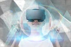 Imagem composta de apontar feliz da mulher ascendente ao usar auriculares da realidade virtual foto de stock royalty free