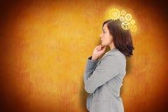 Imagem composta de concentrar a mulher de negócios fotografia de stock