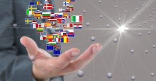 Imagem composta de Digitas da mão do negócio com bandeiras e os pontos de conexão Fotografia de Stock Royalty Free