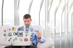 Imagem composta de Digitas do homem de negócios que compra em linha no portátil com ícones no primeiro plano Fotografia de Stock Royalty Free