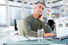 Imagem composta de Digitas do homem de negócios que usa o portátil com ícones na mesa Foto de Stock Royalty Free