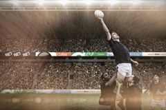 Imagem composta de fãs do rugby na arena Imagens de Stock