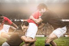 Imagem composta de fãs do rugby na arena foto de stock royalty free