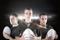 Imagem composta de jogadores resistentes do rugby foto de stock royalty free