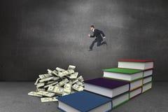 Imagem composta de meio do ar running do homem de negócios novo geeky Imagens de Stock Royalty Free