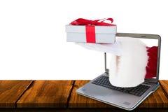Imagem composta de Papai Noel que mostra o presente com fita vermelha Fotografia de Stock Royalty Free