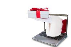 Imagem composta de Papai Noel que mostra o presente com fita vermelha Fotos de Stock