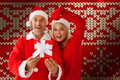 Imagem composta de pares festivos imagem de stock royalty free