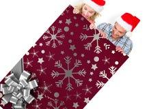 Imagem composta de pares festivos novos Imagens de Stock