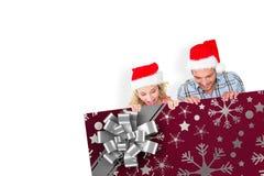 Imagem composta de pares festivos novos Imagem de Stock Royalty Free