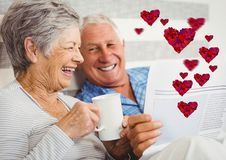 Imagem composta de pares maduros felizes imagens de stock royalty free