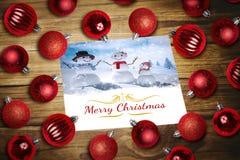 Imagem composta de quinquilharias do Natal na tabela Fotografia de Stock Royalty Free
