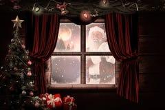 A imagem composta de Santa leva seu saco vermelho e sorri Imagens de Stock Royalty Free