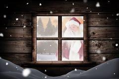 Imagem composta de Santa que pede o silêncio à câmera Imagens de Stock
