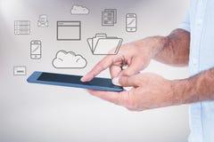 Imagem composta de um homem que usa o tablet pc Imagem de Stock